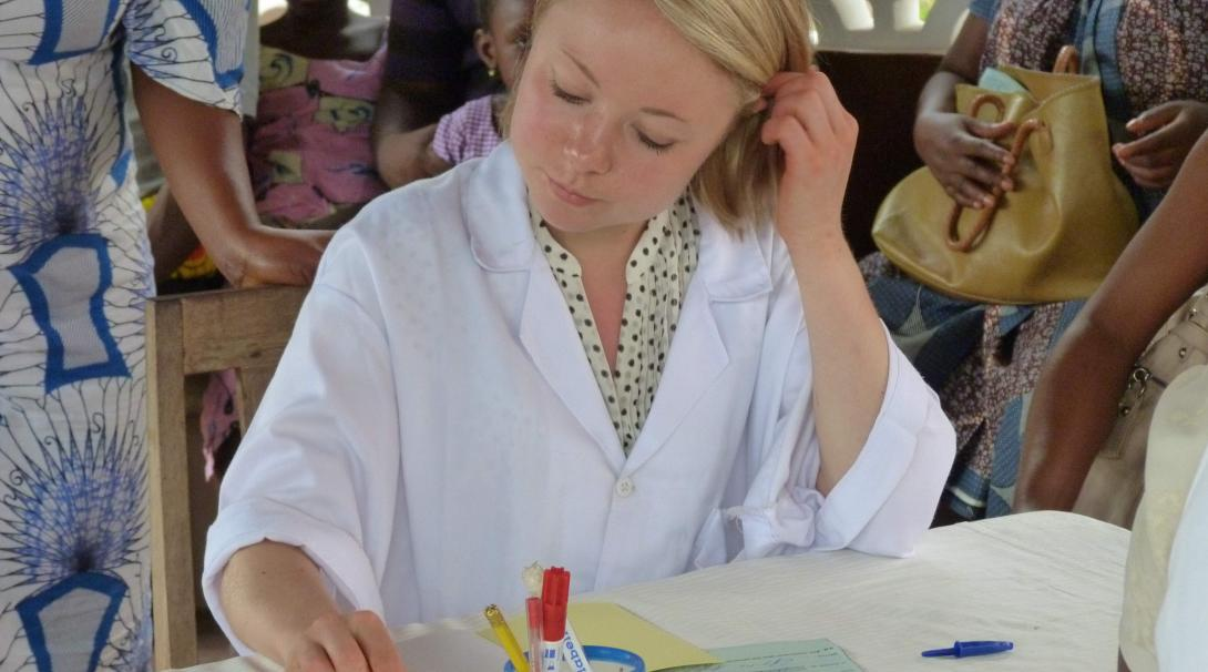 A volunteer doing a pharmacy internship with Projects Abroad in Ghana verifies a medical prescription.